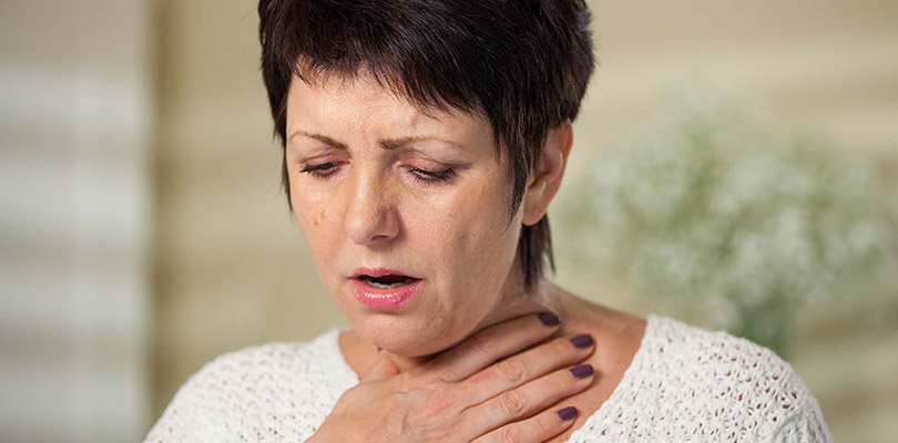 A woman is coughing