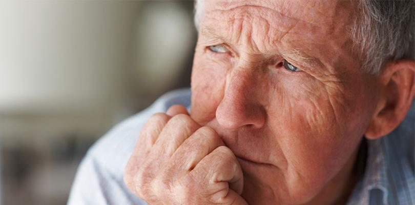 Elderly man looking concerned