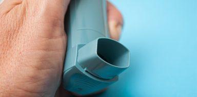 Hand holding an inhaler