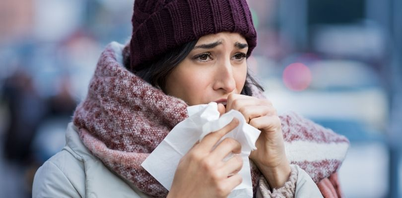 Someone coughing in the cold weather due to COPD.